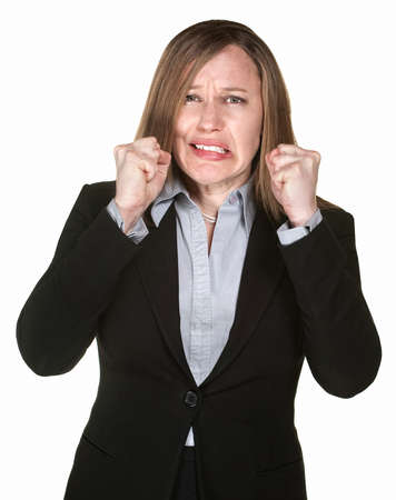 uptight: Anxious Caucasian business woman with clenched fists