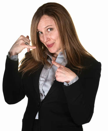 Pretty businesswoman over white background with hands in telephone gesture photo