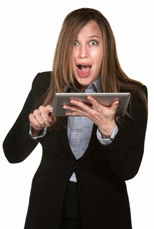 Excited woman holding tablet over white background photo