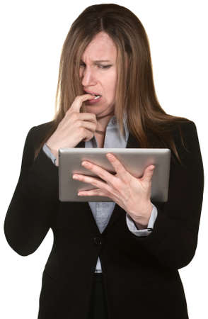 Confused woman holding tablet over white background photo
