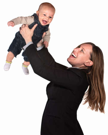 Pretty businesswoman holding her baby over white background Stockfoto