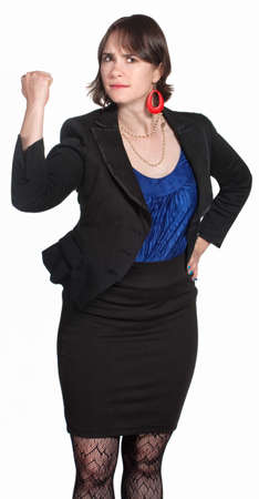 tough woman: Female executive shaking her fist over white background