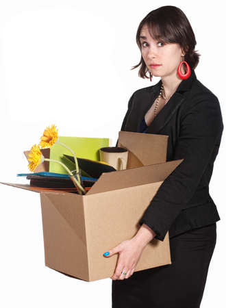 Sad white collar worker with box of stuff over white background