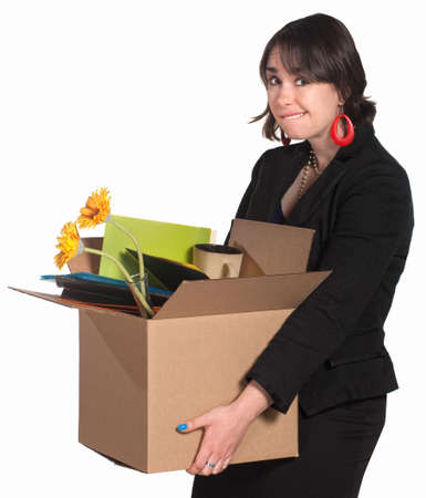 Embarrassed professional woman carrying box of items Stock Photo - 14297690