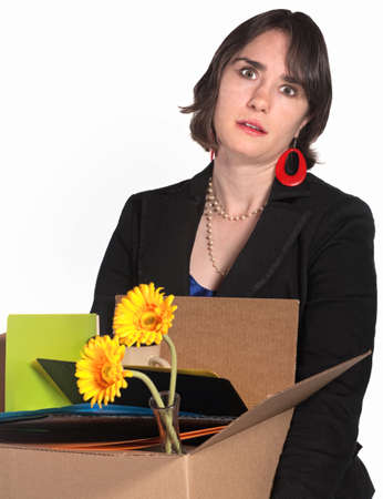 Frustrated woman in black dress carries belongings in box Stock Photo - 14297717