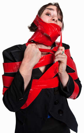 Young female executive tied in red tape photo