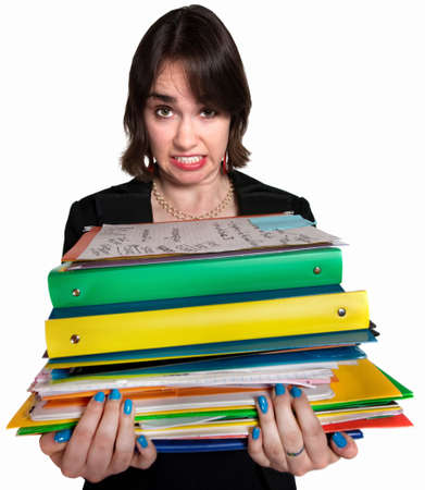 Stressed out female white collar professional with folders photo