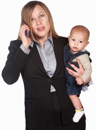 Pretty businesswoman with baby over white background photo