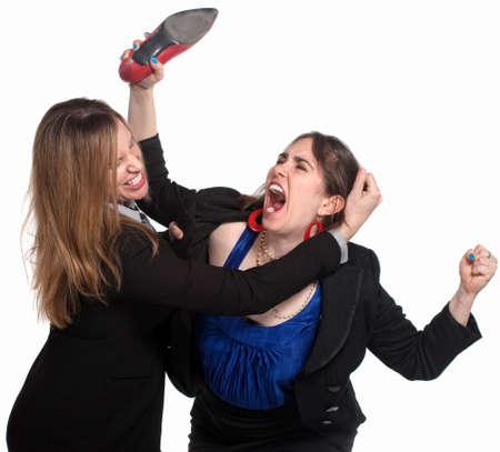 violence in the workplace: Dos mujer profesional luchando sobre fondo blanco Foto de archivo