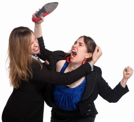rude: Two professional woman fighting over white background