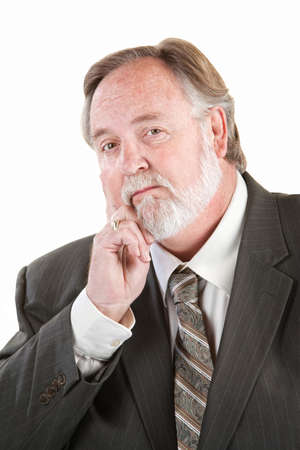 Single mature man with hand on chin photo