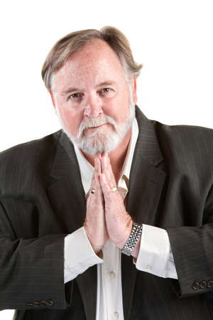 Caucasian man gesturing with his hands to do prayer