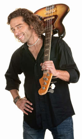 easygoing: Easygoing white male holds a guitar over his shoulder Stock Photo