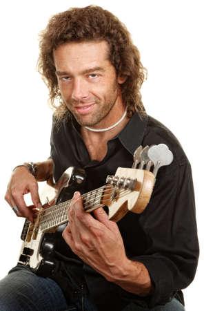 Smiling European man plays guitar over white background photo