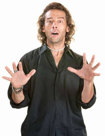 Afraid young European man with hands up photo