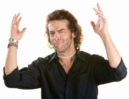 annoyed: Frustrated young male with hands in the air Stock Photo