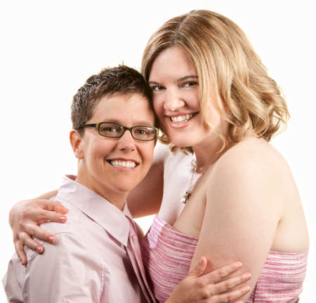 Two happy friends embrace over white background photo