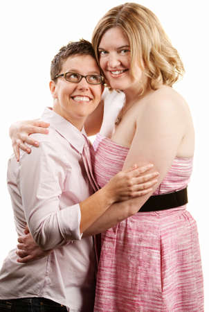 butch: Happy lady looks up to her female companion Stock Photo