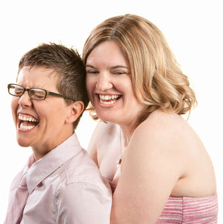 lesbian women: Two European friends laughing together over white background Stock Photo