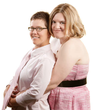 Caucasian lesbian couple embracing over white background photo