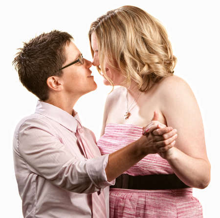 Two lesbian women dancing together over white background photo