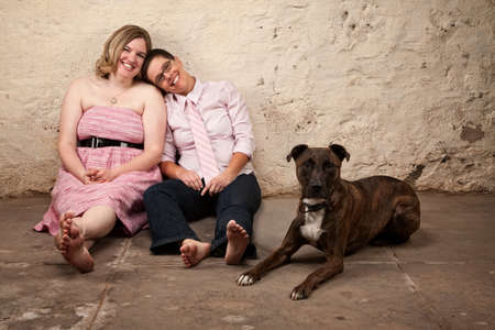 plus size woman: Cute female friends with pet dog in basement