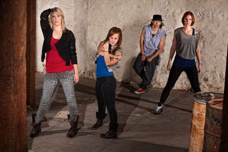 Four young break dancers posing in underground setting Stock Photo - 14484187