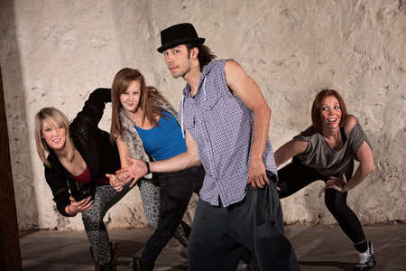 Cool young Hispanic dancer with group in underground setting photo