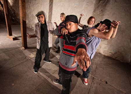 Cool Mexican break dancers in underground setting photo