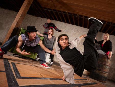 break dance: Cool South Asian teenager break dacing with friends