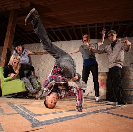 Latino man spinning on his head in break dancing battle