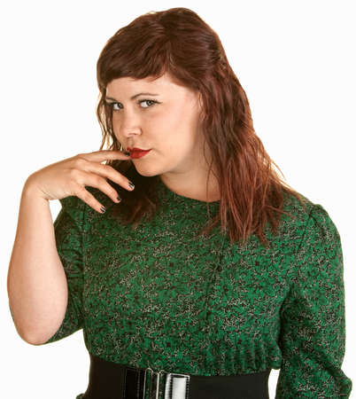 Skeptical woman with finger in mouth over white background photo
