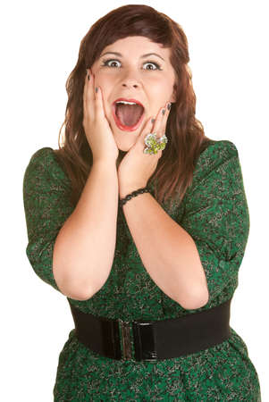 Excited Caucasian lady with hands on her cheeks photo