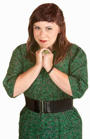 Hopeful young European female in green dress photo