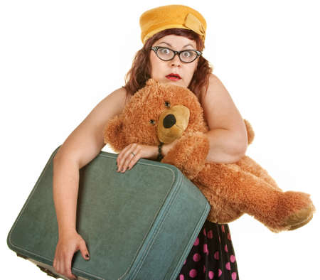 frantic: Tense young woman with toy bear and suitcase