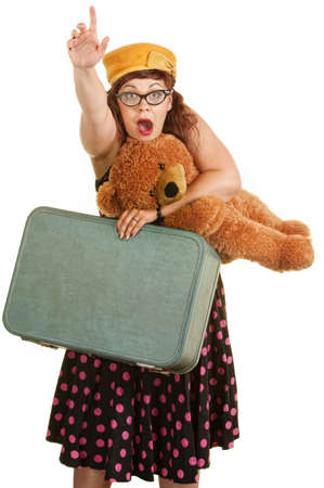 hailing: Retro style woman waving hand with suitcase and teddy bear