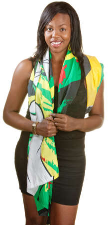 Beautiful young Black woman draped in Jamaican flag photo