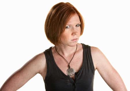 dudas: Molesto mujer cabeza roja sobre fondo blanco Foto de archivo