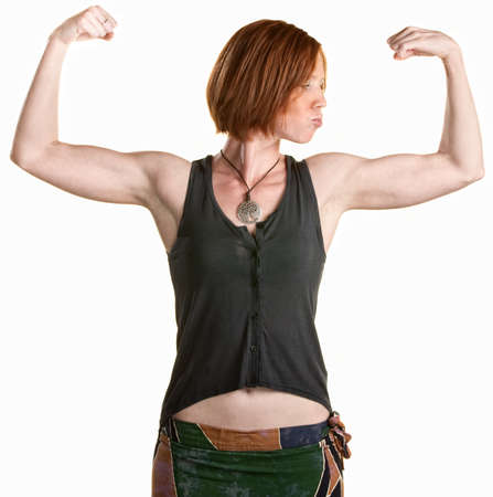 beautiful navel women: Serious young woman flexing her biceps over white Stock Photo