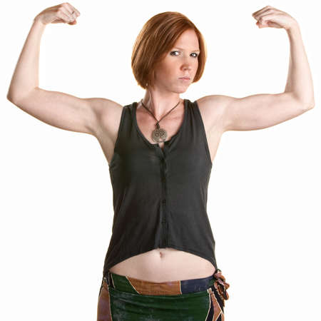 midriff: Serious Caucasian woman flexing biceps over white background