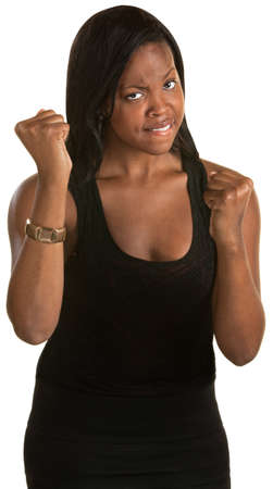struggling: Tough West Indian woman with fists in the air