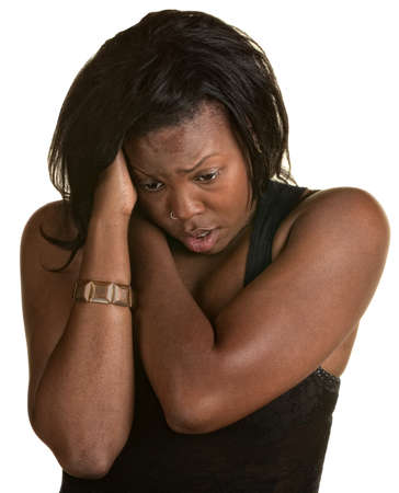 Frantic Black woman holding neck and head photo