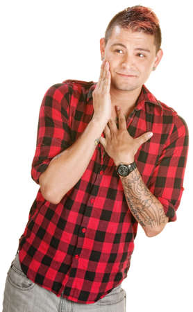 flattered: Bashful young European man in flannel shirt over white