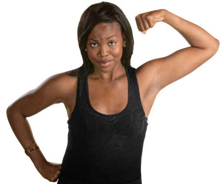 jamaican adult: Smiling Black woman flexes her bicep over white background