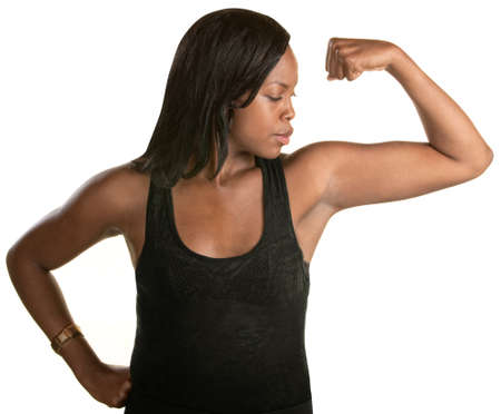 jamaican adult: Serious young woman flexes her arm over white background