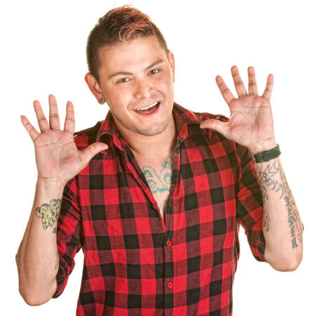 spiked hair: Happy Latino man with spiky hair and hands in the air