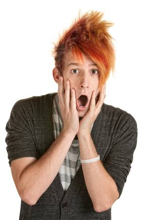 aghast: Shocked man in orange spiky hair over white background
