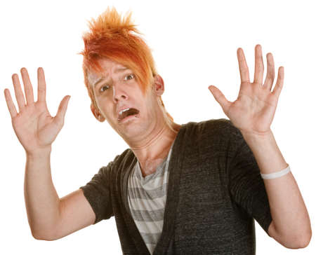 Frightened man in orange spiky hair with hands up Banque d'images