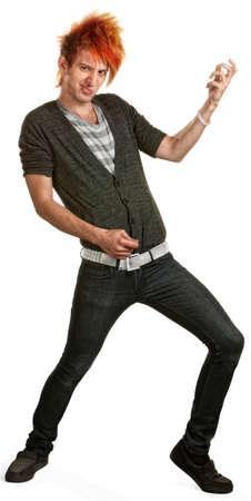air guitar: Teen punk with orange mohawk playing air guitar