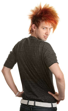 spiky hair: Young man with orange mohawk looking over his shoulder